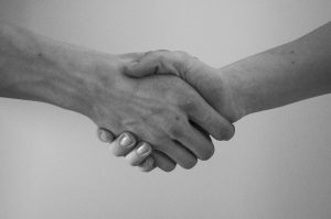 Black and white photo of a handshake