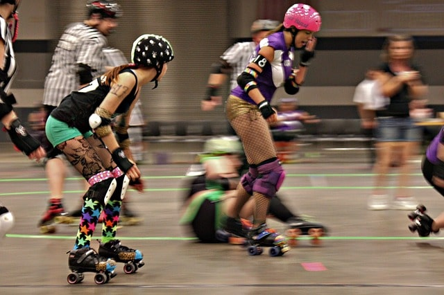 Action shot of girls playing roller derby
