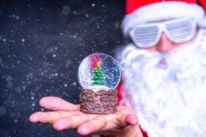 Party Santa holding Christmas tree snowglobe