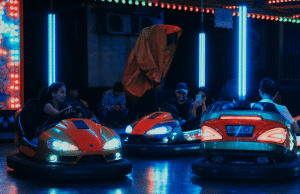 People riding in bumper cars